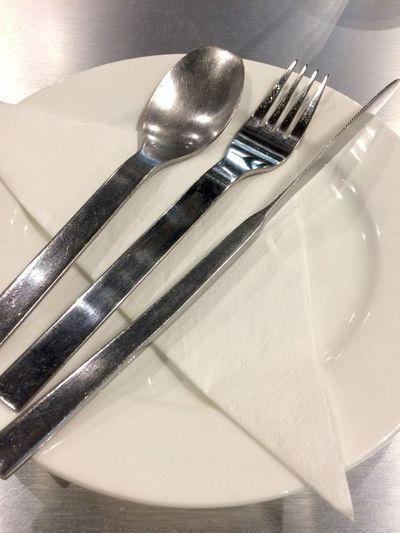 Kitchen Utensil Eating Utensil Fork Household Equipment Plate Spoon Indoors  Close-up Still Life Table Knife Knife No People Metal Table Silverware  High Angle View Food And Drink Restaurant Silver Colored Shiny