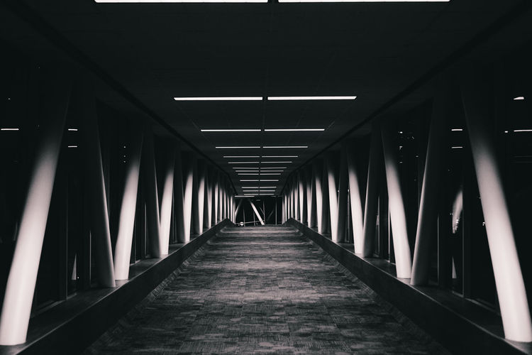 Empty hallway Architecture Built Structure Connection Diminishing Perspective Empty Engineering In A Row Long Modern Narrow No People Symmetrical Symmetry The Way Forward Vanishing Point Walkway The Architect - 2016 EyeEm Awards