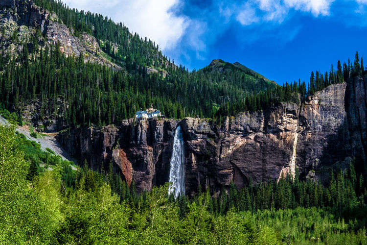 Bridal Veil Falls in Telluride, Colorado Colorado Colorado Photography Denver Powerhouse Telluride Trees Beauty In Nature Bridal Veil Falls Cloud - Sky Day Forest Geology Green Color Landscape Mountain Nature No People Outdoors Physical Geography Rock - Object Scenics Sky Tranquil Scene Tranquility Tree