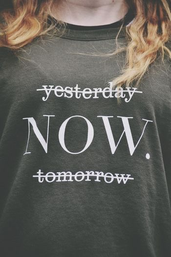 Now Text Western Script Message Communication Single Word Close-up One Person Day People Text Standing Young Adult Now Live Now Words Of Wisdom... Wisdom Words Word Fashion Front View Real People Casual Clothing