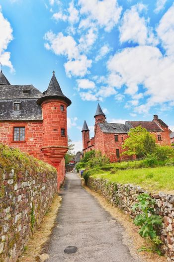 The Beautiful Village Of Collonges La Rouge in France Building Exterior Cloud - Sky Architecture Sky Built Structure History Outdoors The Way Forward Day No People Fortified Wall Tree Place Of Worship