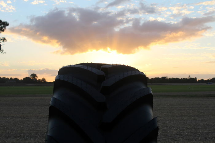 Agriculture Cloud Cloud - Sky Dramatic Sky Farm Field No People Outdoors Rural Scene Scenics Sky Sunset Tractor Tractor Tyre Tranquil Scene Tyre