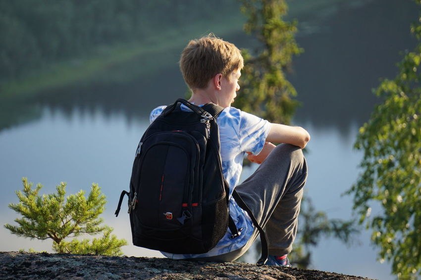One Person Lake Day Outdoors Water Rear View Sunlight Nature Adventure Focus On Foreground From Above  Enjoying Life Silent Moment Resting Relaxing Top Of The Hill Skuleberget Högakusten Reflections In The Water Reflections Evening Light