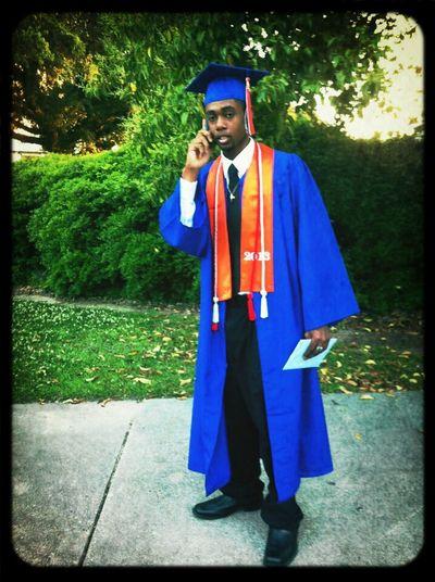 on the phone @ graduation lol