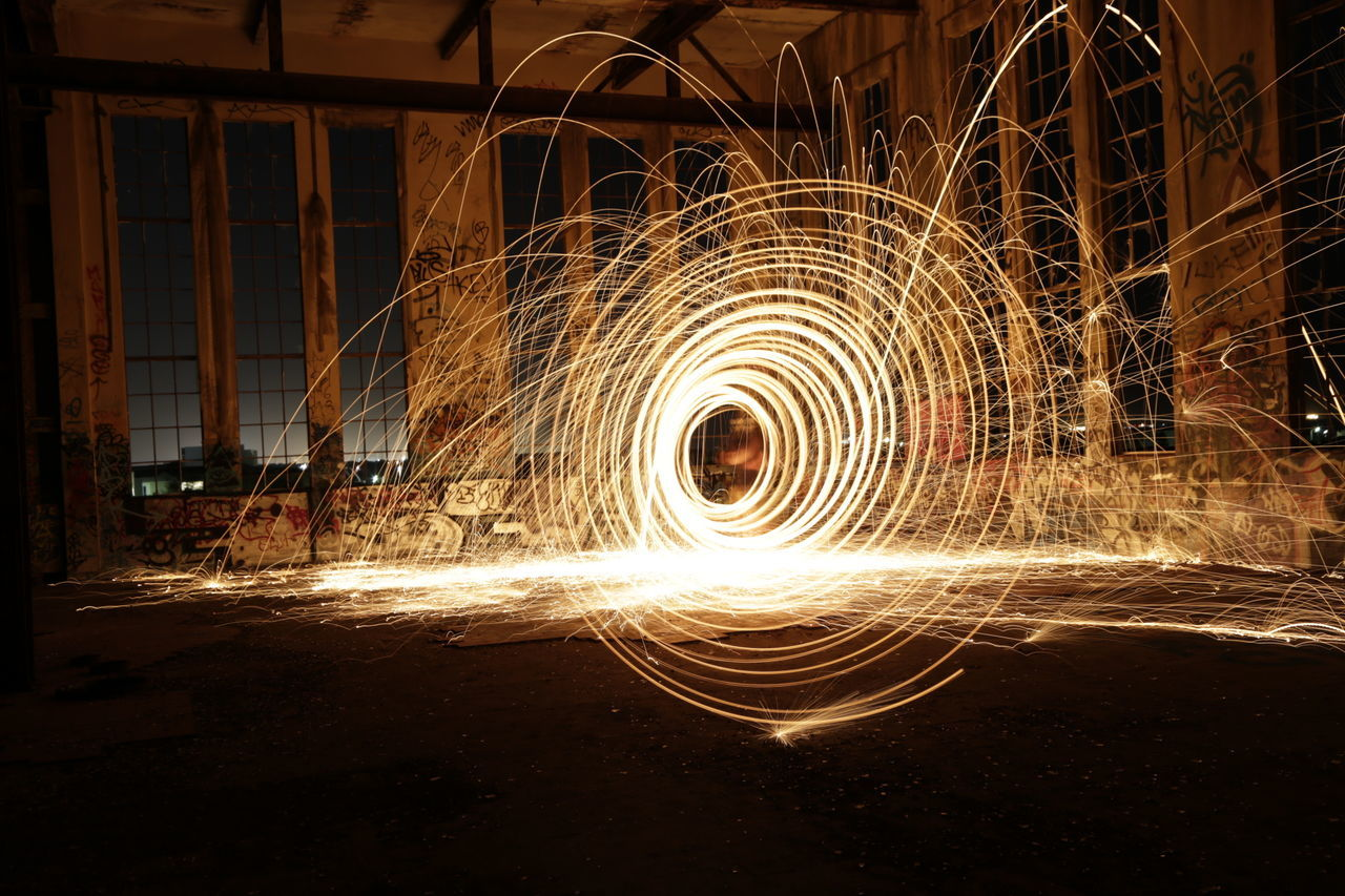 long exposure, wire wool, motion, spinning, light painting, night, blurred motion, speed, illuminated, indoors, one person, people