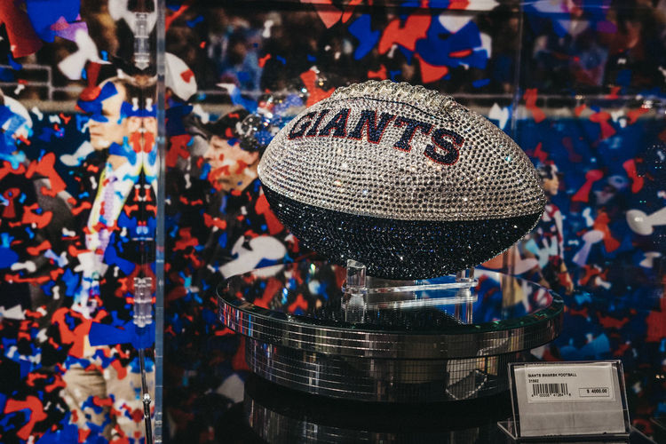 Swarovski Giants ball on sale in NFL Experience in Times Square, New York, a first-of-its-kind live action attraction, combining interactive games and 4D theatre. Tourism Travel United States USA New York City New York Swarovski NFL Giants NFL Teams American Football - Sport American Football - Ball Decorated Sport Luxury Football Retail  Close-up For Sale Retail Display NFL Experience Times Square NYC No People Focus On Foreground Swarovski Crystals