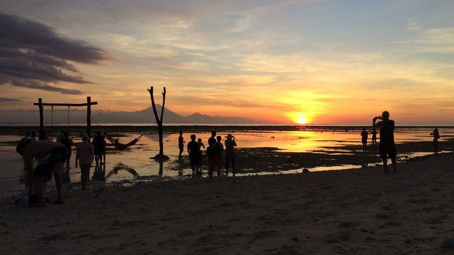 Sunset Beach Sea Sand Nature Sky Lifestyles Water Enjoyment Horizon Over Water Bali, Indonesia Hamhock Sun People Watching Group Of People People Sommergefühle Connected By Travel