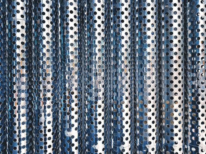 Full Frame Background of Shiny Metallic Corrugated Perforated Sheet Alloy Arrangement Backgrounds Close-up Corrugated Metal Day Full Frame Hole In A Row Indoors  Industry Large Group Of Objects Metal No People Pattern Perforated Perforated Metal Pattern Repetition Shape Side By Side Silver Colored Steel Still Life Textile Textured