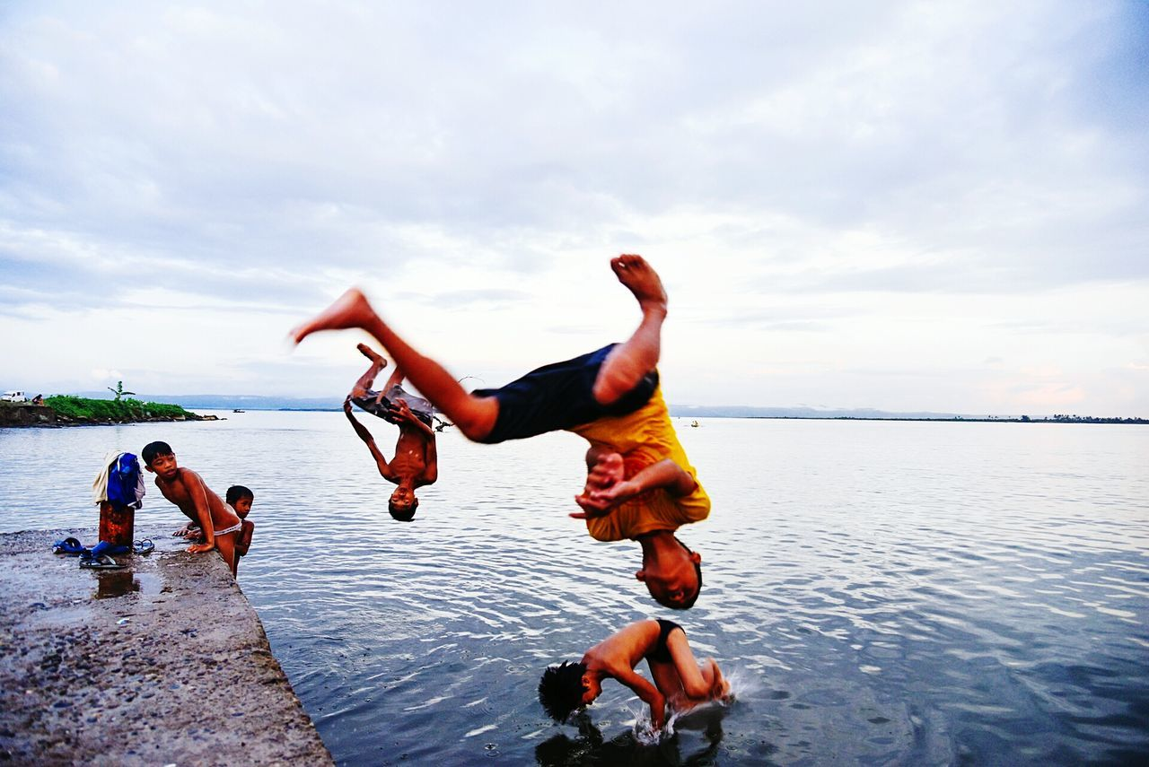 WOMAN JUMPING ON SHORE