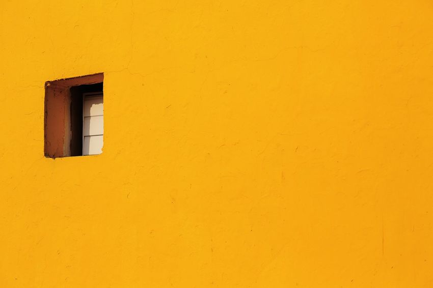 EyeEmNewHere Taking Photos Architectural Detail Architecture Building Building Exterior Built Structure Copy Space Frame House Light And Shadow Low Angle View Minimalism No People Orange Color Outdoors Residential District Security Simplicity Sunlight Wall Wall - Building Feature Window Window Frame Yellow