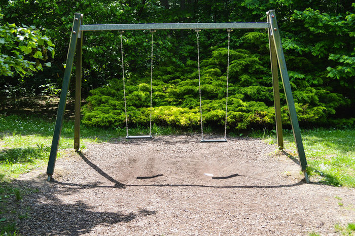 empty swings Absence Beauty In Nature Childhood Day Empty Green Green Color Leisure Activity Lifestyle Lush Foliage Nature No People Outdoors Park Park - Man Made Space Playground Sunlight Swings The Great Outdoors - 2016 EyeEm Awards TheWeekOnEyeEM Tranquility The Essence Of Summer