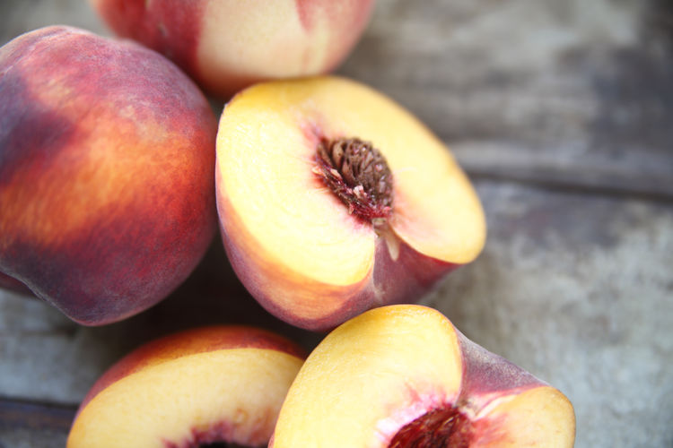 Close-up of peaches on table