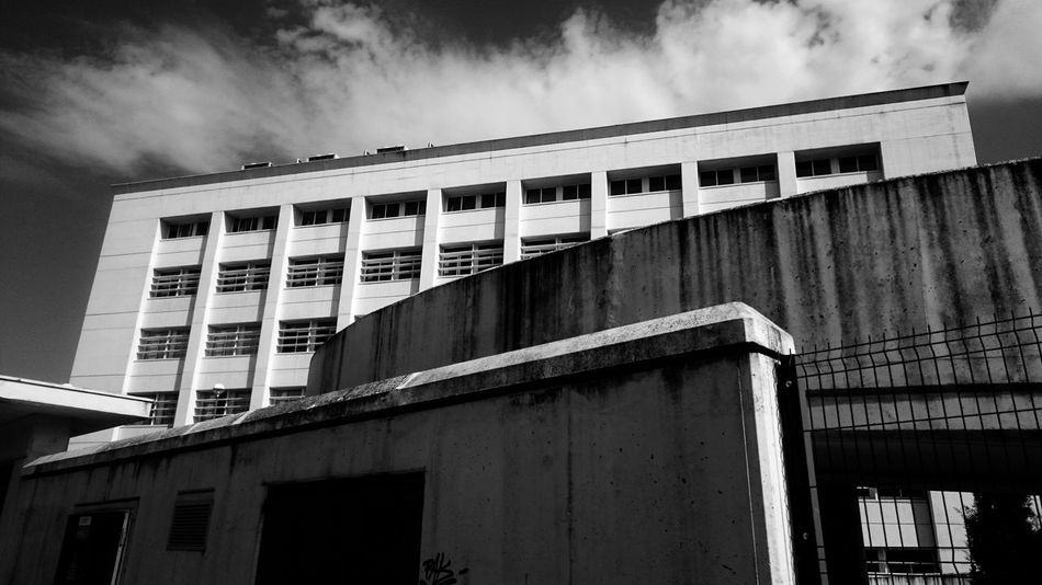 Facultad de Ingeniería Architectural Column Architecture Black And White Blackandwhite Building Building Exterior Built Structure City Cloud - Sky Clouds And Sky Day Façade In A Row Low Angle View Monochrome No People Outdoors Pattern Residential District Sky Travel Destinations Window