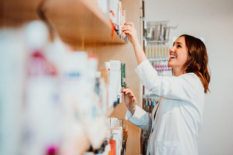 Smiling female pharmacist working at store