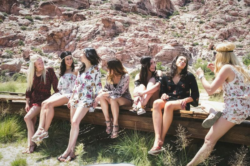 Fun Enjoyment Friendship Togetherness Outdoors Day Lifestyles Summer Carefree Real People Happiness Sitting Young Women Nature Cheerful Natural Young Adult Desert Fashion Romper Floral Bohostyle Bridesmaids Bohemian