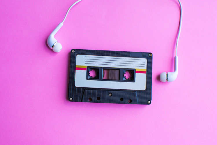 Retro Tape Cassette Old Vintage Pink Color Technology Indoors  Connection Pink Background Close-up Studio Shot Communication No People Still Life Colored Background Retro Styled Directly Above Music High Angle View Wall - Building Feature Listening Purple Single Object Electrical Equipment