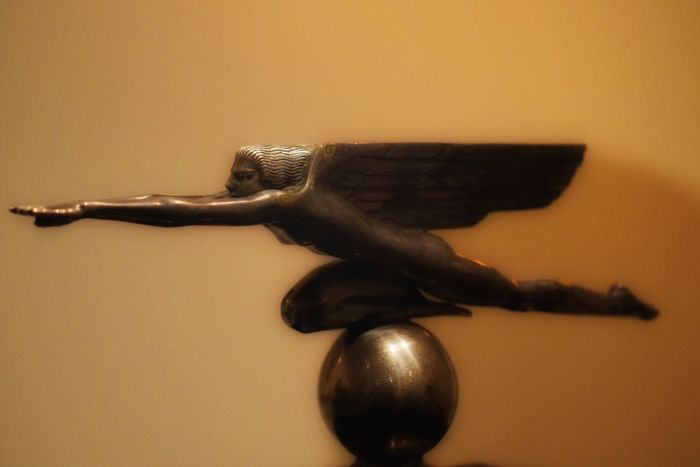 Art Nouveau Hood Ornament Retro Future Vision Forward Winged Statue Close-up No People Studio Shot Indoors  Day