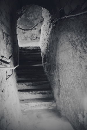 Valkenburg Castle Ruins series (My travel photo series last December to the Netherlands). Stones Black And White Black And White Photography Ruin Built Structure Light Ruins Basement Spooky Steps Staircase Steps And Staircases Tunnel Old Ruin Ancient Civilization Ancient Light At The End Of The Tunnel Historic The Architect - 2018 EyeEm Awards