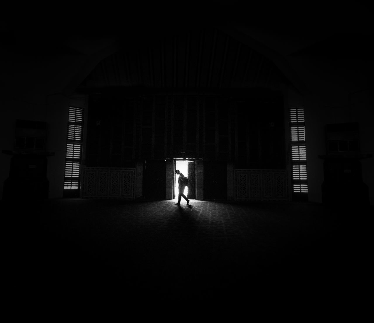 one person, architecture, built structure, indoors, real people, full length, dark, building, rear view, walking, direction, lifestyles, the way forward, day, domestic room, men, copy space, arcade, silhouette, light at the end of the tunnel, ceiling