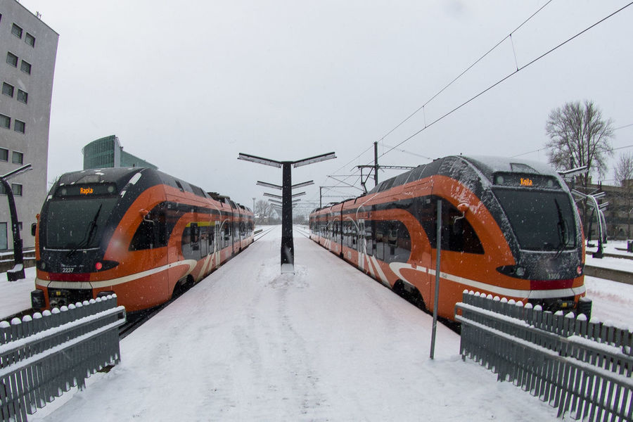 Balti Jaam Cold Temperature Day Elron Environment Fisheye Mode Of Transport Nature No People Orange Color Outdoors Public Transportation Snow Snowing Stadler Tallinn Trains Transportation Weather Winter