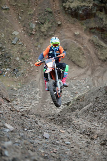 View of person riding motorcycle on mountain