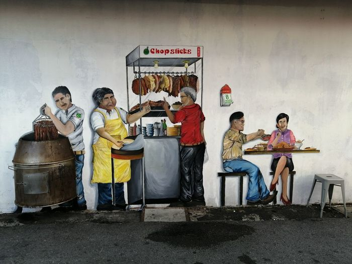 Group of people sitting on wall