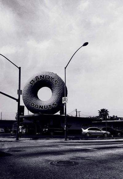 Randy's Donuts! IPhoneography IPhone Photography Travel Photography Mobilephotography Iphoneonly Mobile Photography Obscura Camera App IPhone 6s Plus Light And Shadow Black & White Noir Streetphotography Street Photography Rands Snapseed California
