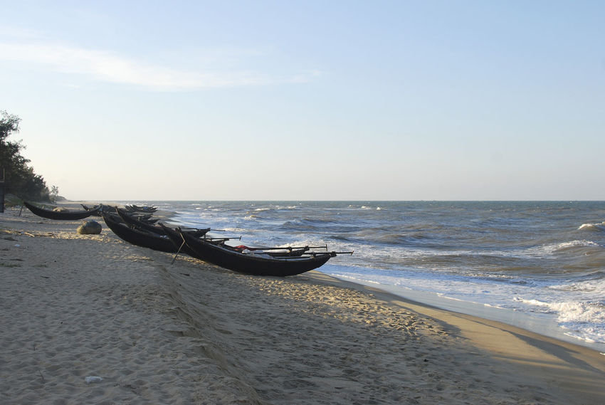 On the beach in Hue, Vietnam Beach Beauty In Nature Blue Boat Calm Day Horizon Over Water Hue, Vietnam Huế Nature Nautical Vessel Non-urban Scene Outdoors Sand Scenics Sea Seascape Shore Sky Tranquil Scene Tranquility Transportation Travel Destinations Vietnam Water