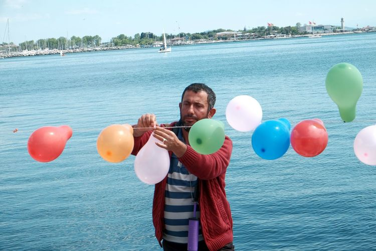 The Portraitist - 2016 EyeEm Awards Baloons Man Bang Bang!!  Sunnyday☀️ Sunny Day Colorful Seaside Sea And Sky