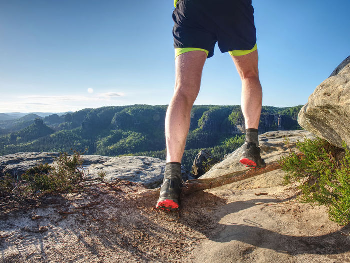 Healthy lifestyle middle aged man runner running on mountain trail in sunset