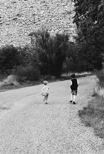 Two People Childhood Child Rear View Walking Togetherness Boys Real People Day Leisure Activity Nature Outdoors Bonding People Brothers