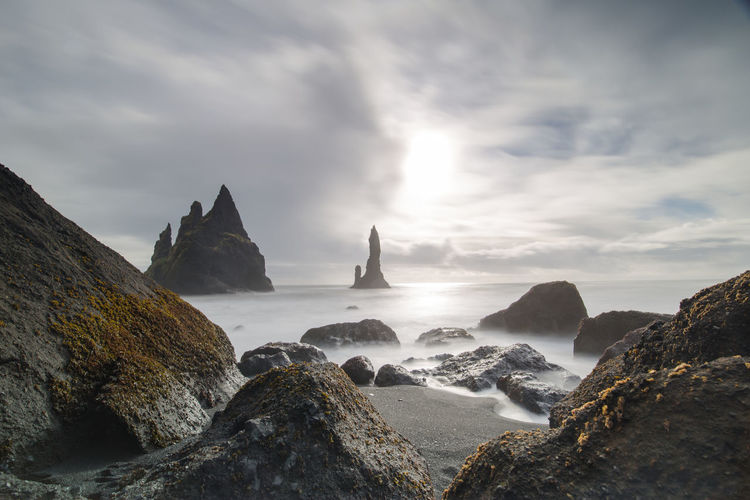 Reynisfjara Beach Reynisdrangar Vík í Mýrdal Iceland Black Beach Iceland Black Sand Beach Rock Cloud - Sky Beauty In Nature Water Sea Rock - Object Nature Tranquil Scene Beach Day Stack Rock Land No People Beauty In Nature Beauty Beautiful Nature Sun Travel Photography Landscape
