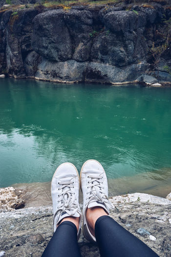 Day EyeEnNewHere Greece High Angle View Human Body Part Human Leg Lake Landscape Lifestyles Nature One Person Outdoors Rock - Object Shoe Water