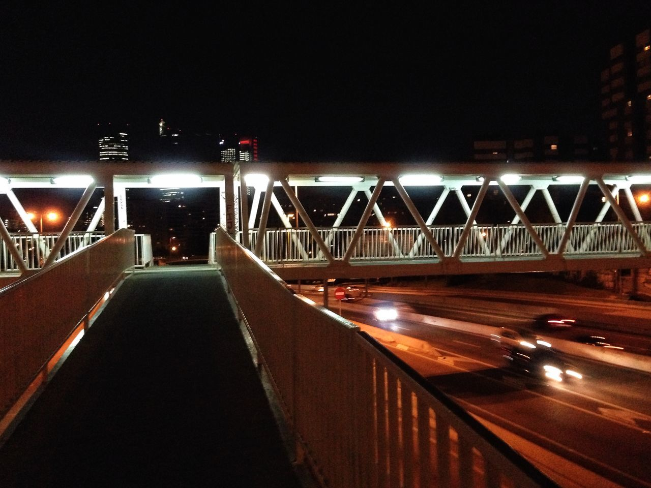 illuminated, night, transportation, bridge - man made structure, the way forward, architecture, street light, bridge, lighting equipment, built structure, speed, connection, motion, road, light trail, outdoors, no people, high street, city, sky