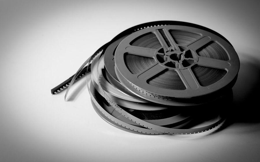 Vintage movie symbol Black And White Cinema Close-up Entertainment Film MOVIE No People Old Projection Reel Studio Shot Super 8 Symbol Vintage