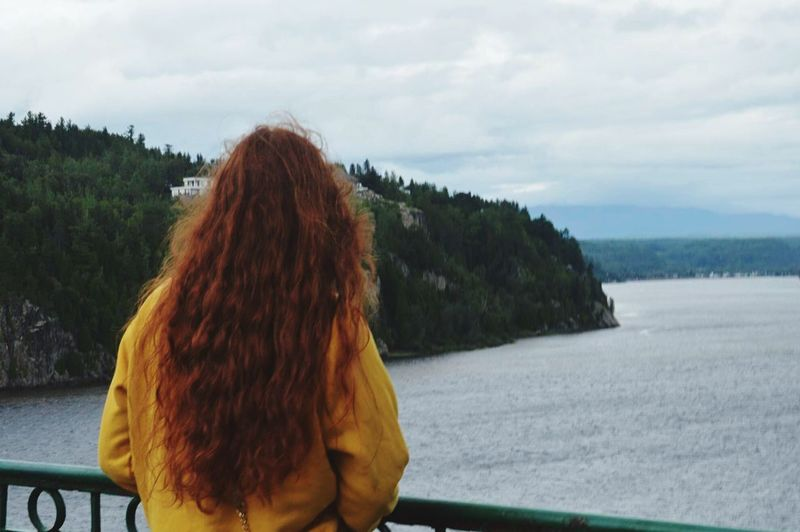 Rear View Cloud - Sky Redhead Sky Real People Nature River One Person Day Mountain Tree Outdoors Water Scenics Women Leisure Activity Landscape Beauty In Nature Standing Young Women