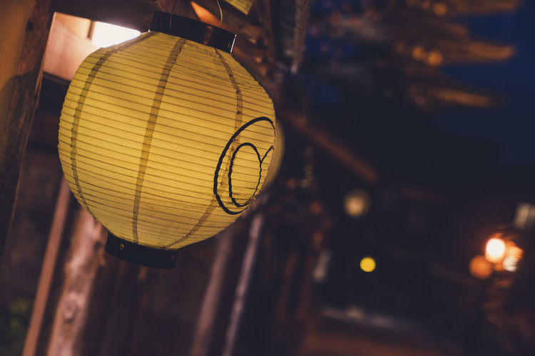 Close-up of illuminated lantern hanging at night