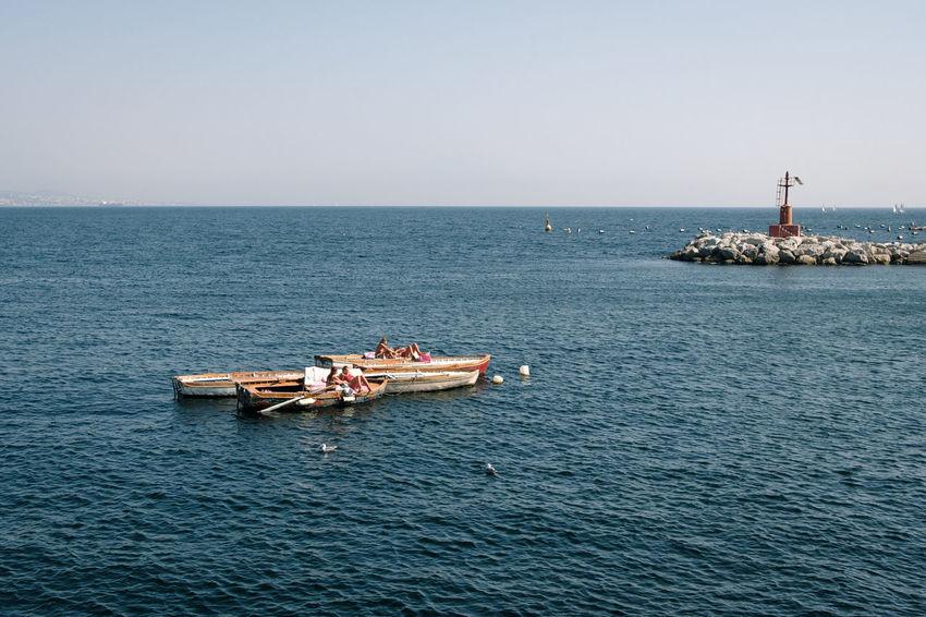 Abbronzatura, Napoli - 2018 23mmf2 FUJIFILM X-T2 Napoli Tanning Campania First Eyeem Photo Fujifilm Horizon Over Water Italy Minimal Nautical Vessel Relaxation Sailboat Scenics - Nature Sea Sky Water Waterfront