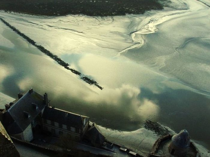 Clouds on the water. Mont-Saint -Michel France