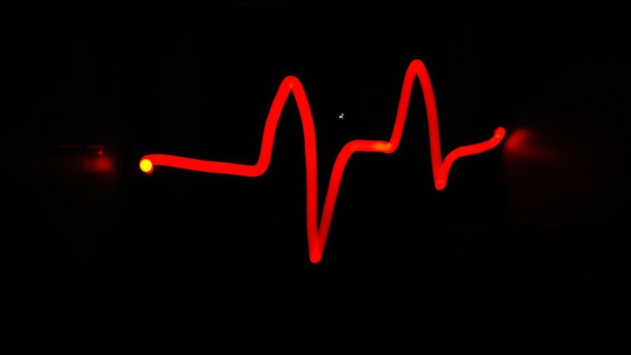Heart beat in long exposure. Life Alive  Long Exposure Heart Beat Black Background Red Close-up Neon Light Painting Neon Colored Darkroom Glowing Fluorescent Light Light Trail Defocused Fluorescent