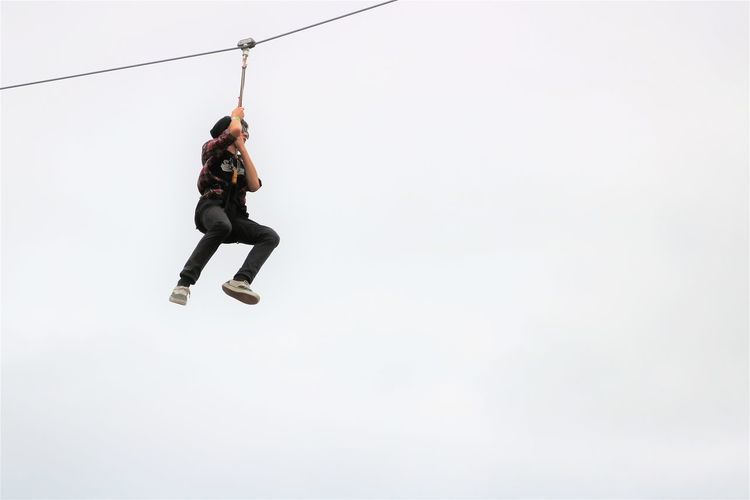 Hangin' Brave Hanging Swinging Activity Adventure Challenge Climbing Copy Space Dangerous Determination Effort Extreme Sports Freedom Full Length Low Angle View Mid-air Motion One Person RISK Rope Skill  Sport Young Adult Zipline Ziplining Be Brave A New Beginning This Is Strength A New Perspective On Life Human Connection Capture Tomorrow Moments Of Happiness 2018 In One Photograph Redefining Menswear My Best Photo Humanity Meets Technology 17.62°