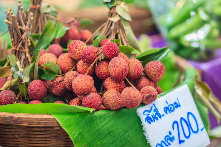 Fresh lychee fruit for sale at the fresh market. Lychee also variously spelled as litchi, liechee, liche, lizhi or li zhi, or lichee, a tropical tree native to the Guangdong province of China. Lychee Fruit Close-up Container Day Focus On Foreground Food Food And Drink For Sale Freshness Fruit Healthy Eating Large Group Of Objects Leaf Lichee Litchi Lychee Lychees Market Market Stall No People Retail  Retail Display Ripe Sale Still Life Text Tropical Fruit Wellbeing