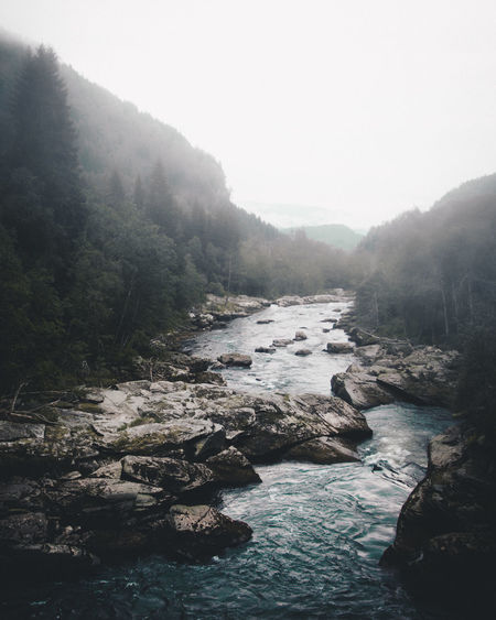 Tranquil Norway Beauty In Nature Day Environment Flowing Flowing Water Fog Forest Nature No People Outdoors Plant River Rock Rock - Object Scenics - Nature Sky Solid Tranquil Scene Tranquility Tree Water