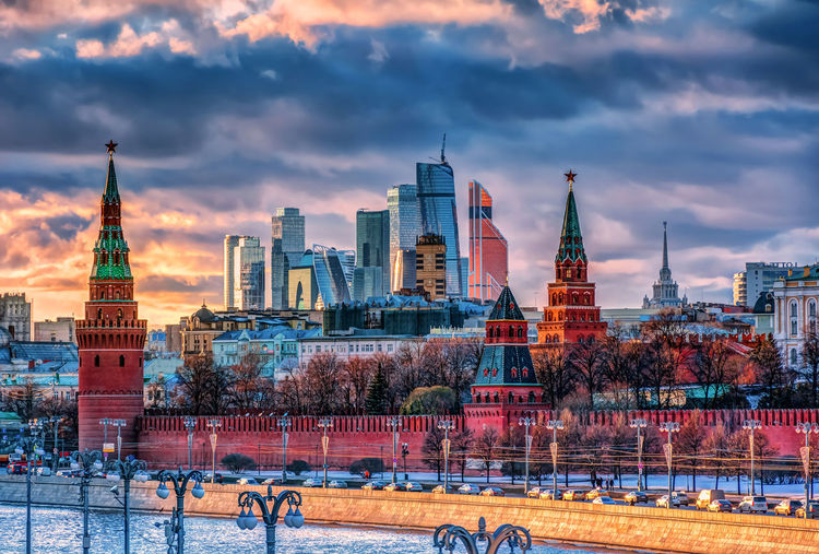 Buildings in city against cloudy sky, moscow city and kremlin