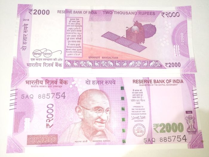 Indian two thousand rupee note 2000 Adults Only Banknote Business Business Composite Image Currency Indian Data Finance Finance And Economy Indian Culture  Indian Currency Indian Two Thousand Rupee Note Men New Number One Man Only Only Men Paper Currency Pink Color Savings Success Technology Two Thousand Rupee Note Wealth