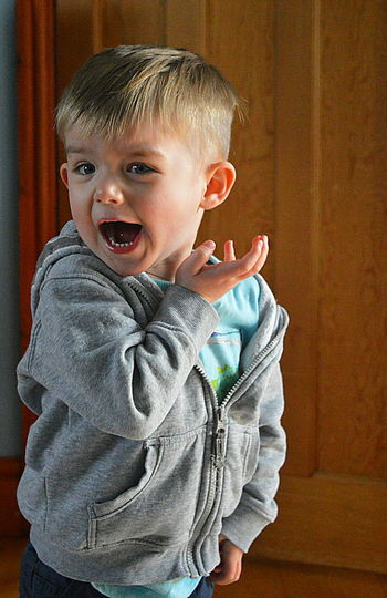 Portrait Of Boy Screaming At Home