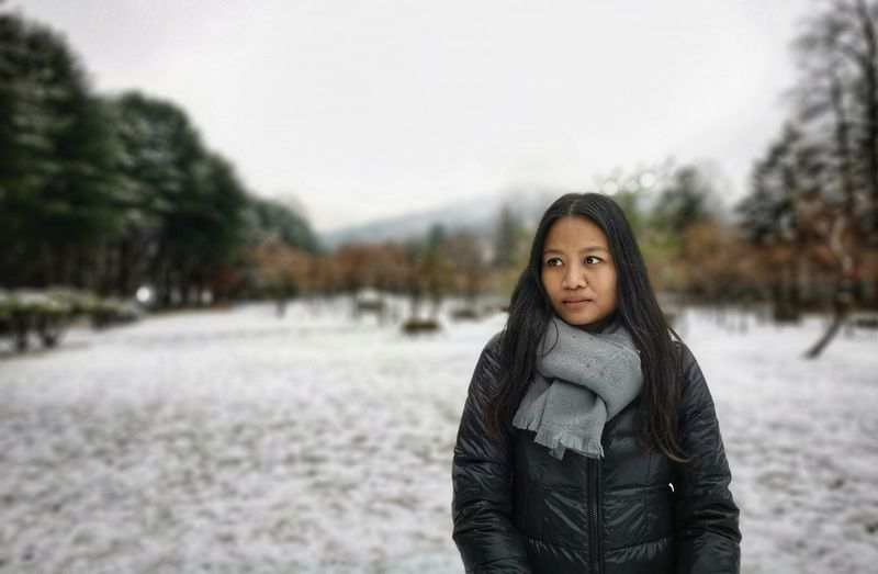 Portrait of young woman standing in winter