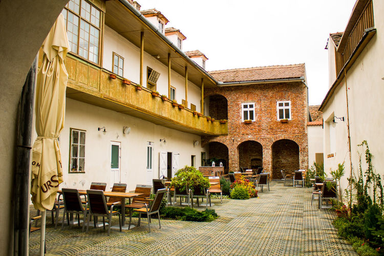 Architecture Building Exterior Built Structure Chair Courtyard  Courtyard House Day Hidden Hidden Gems  Hidden Places House Houses And Windows Luxury No People Outdoors Residential Building Romania Sibiu Sky Table Travel Destinations Window