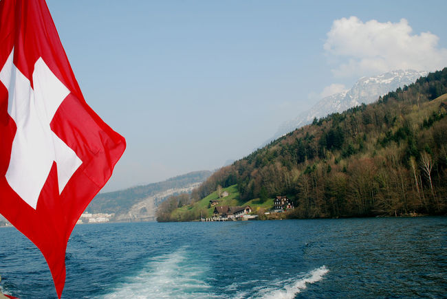 Schweiz Beauty In Nature Cloud - Sky Dampfschiff Day Flag Independence Motion Mountain Nature No People Outdoors Patriotism Plant Red Scenics - Nature Sea Sky Tranquil Scene Tree Water Waterfront