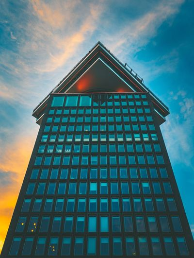 Looking up! Urban Urban Geometry Sunset_captures Netherlands Highrise Building Architecture Sky Architecture Building Exterior Built Structure Low Angle View Cloud - Sky Building Geometric Shape City Tall - High Modern Office Building Exterior Sunset Window